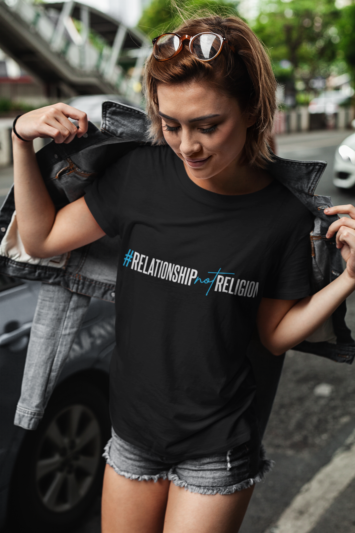 t-shirt-mockup-featuring-a-short-haired-woman-at-a-city-street-417-el